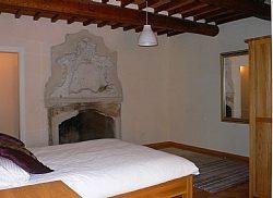 Copy of apartment-peccioli-italian-holiday-letting-bernini-bedroom-with-original-fireplace-1909699